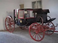 the family Carriage with the hand painted Family Crest